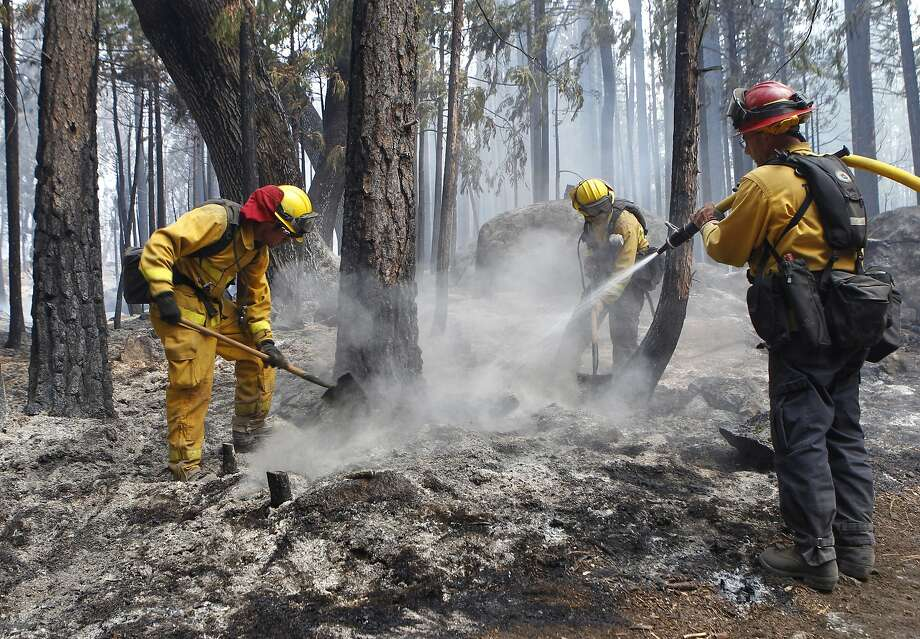 A Stanislaus County fire crew douses a hot spot from the Rim Fire on Aug. 23. Photo: Paul Chinn, The Chronicle