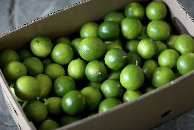 MIAMI, FL - MARCH 26:  Limes that have been imported from Columbia are boxed at Marco produce on March 26, 2014 in Miami, Florida. Marco Carmenatis from the produce company said they hadn't received any lime imports from Mexico for the last three days as a tight supply in Mexico has driven up the availability as well as the prices for the citrus in the United States.  (Photo by Joe Raedle/Getty Images) Photo: Joe Raedle, Staff / 2014 Getty Images