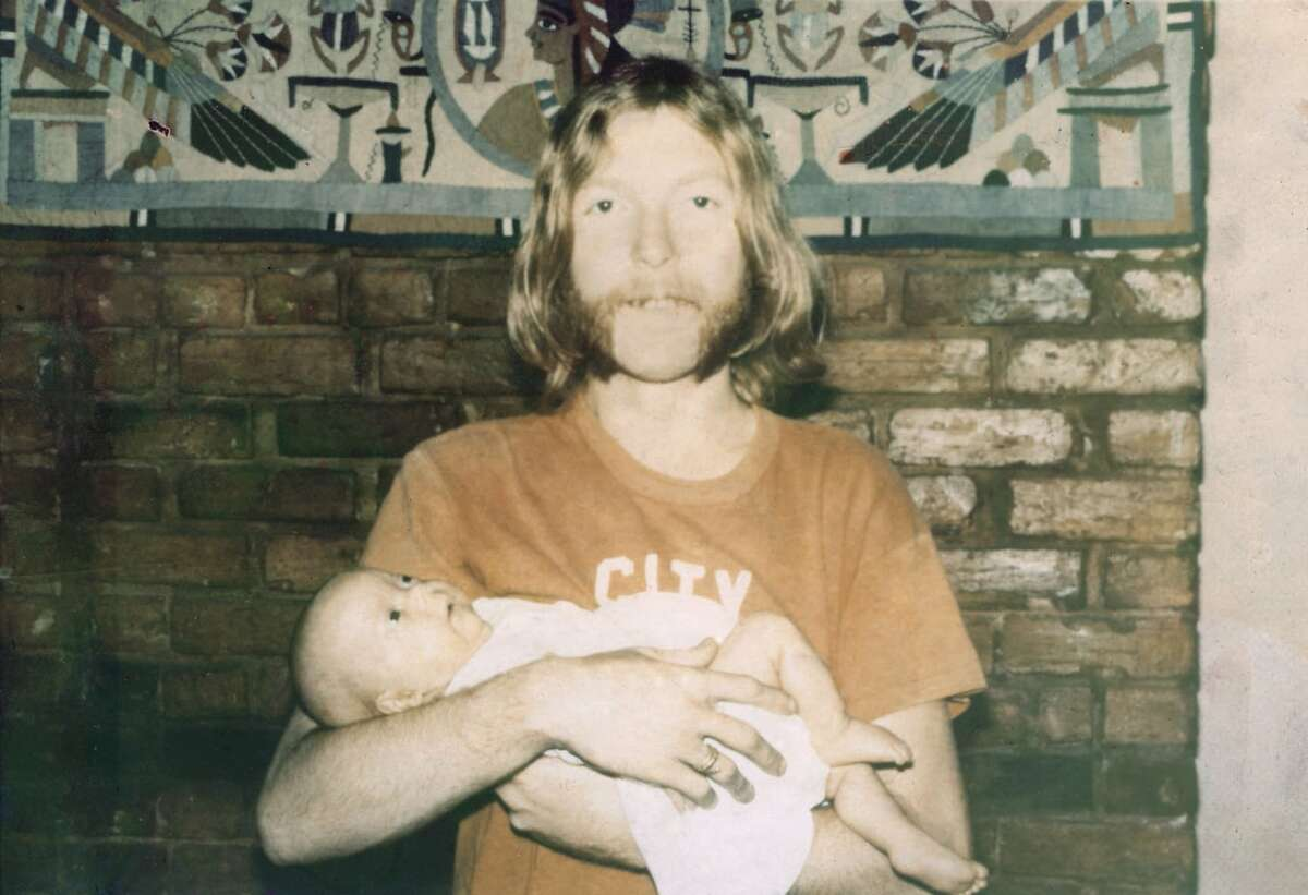 Duane Allman hold Galadrielle as a baby.