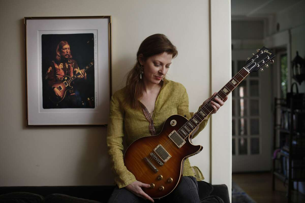 Galadrielle Allman, daughter of Duane Allman, founder of Allman Brothers who crashed his motorcycle and died when he was 24 and she was 2, poses for a photo in her home on Wednesday, March 19, 2014, in Berkeley, Calif. Allman has written a book about her dad called