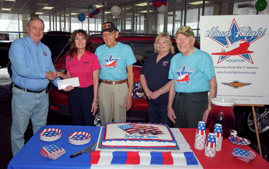 Edd Harshbarger, Honor Flight Houston chairman, receives a $1,000 check from Tamara Ross, Tomball Ford. Next to Ross are Cliff Currin, WWII veteran; Rhonda Harshbarger, Honor Flight Houston co-chair; and Andy Ferguson, WWII veteran.