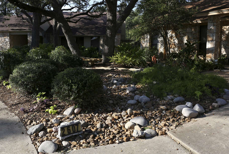 A reader urges a greater emphasis on xeriscaping, the desert-style landscaping exhibited by this home, featured during the 2013 Watersaver Landscape Tour in San Antonio. Photo: Express-News File Photo / San Antonio Express-News