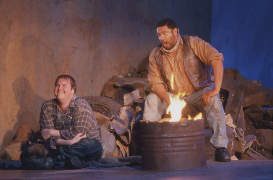 "Houston Grand Opera's 2002 production of Carlisle Floyd's ""Of Mice and Men"" L-R: Lennie (Anthony Dean Griffey) and George (Gordon Hawkins) photo by George Hixson.   HOUCHRON CAPTION (02/04/2002):  George (baritone Gordon Hawkins) sings passionately of hope and frustration in HGO's co-production of Carlisle Floyd's ""Of Mice and Men,"" directed by Francesca Zambello. Photo: George Hixson"