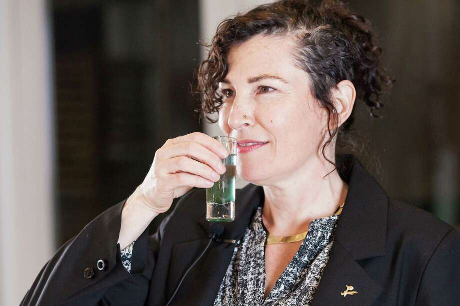 "Artist Marina Zurkow drinks the Blue-Green Algae in Local Water during her ""Outside the Work"" dinner at Rice University's Brochstein Pavilion on March 20, 2014. Photo: Lynn Lane / ONLINE_YES"