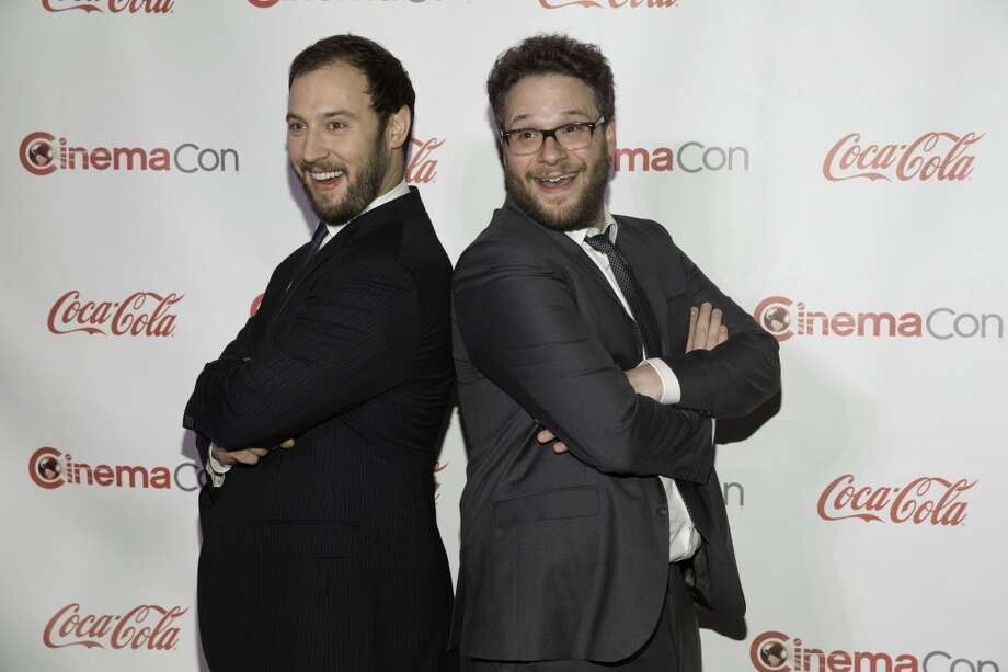 Evan Goldberg, left and Seth Rogen arrive at the CinemaCon Big Screen Achievement Awards, Thursday, March 27, 2014 at Pure Night Club, at Caesars Palace in Las Vegas. Photo: Eric Jamison, Associated Press