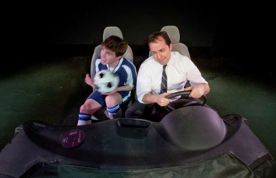 "3/24/14: The play ""Sixty Miles to Silver Lake "" by Dan LeFranc played by (left) Jacob Perkel who plays Denny, the son and (right) John Dunn who plays Ky; the Dad will be shown at the Theater LaB production at Obsidian Art Space, 3522 White Oak , Houston, Texas   The play opens up March 26 runs through April 1, 2014.  The play explores the relationship of a divorced dad and his son, through the long drives they take each weekend when the father (who has weekend custody) picks the son up after soccer practice to drive him dad's home 60 miles away. The play unfolds as a composite of all the rides the two share over many years. Photo: Thomas B. Shea / © 2014 Thomas B. Shea"