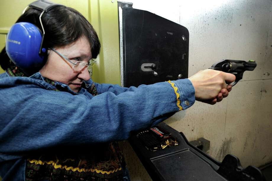Lois Grebosky, 61, of Woodbury, Conn., practices target shooting at Shooters Pistol Range in New Milford, Wednesday, February, 12, 2014. Photo: Carol Kaliff / The News-Times