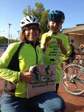 Kara Vuicich and daughter Ruth stop by the North Berkeley BART Energizer Station
