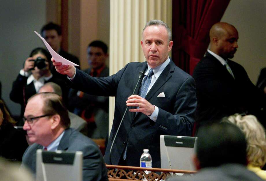 California Senate President Pro Tem Darrell Steinberg, D-Sacramento, introduces a resolution to suspend three Democrats who face charges in criminal cases on the floor of the Senate in Sacramento, Calif., on Friday, March 28, 2014. The  resolution, which passed 28-1, prevents Democratic Sens. Ron Calderon, Leland Yee and Rod Wright from exercising any power of their office until the pending criminal cases against them have been resolved.(AP Photo/Steve Yeater) Photo: Steve Yeater, FRE / FR69238 AP