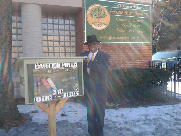 """""""Pastor Edward Smart of the GWU Center, 274 Washington Avenue shows off the new Little Free Library, a program of Grassroot Givers"""""""
