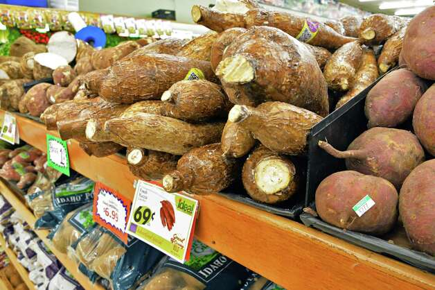 Fresh yucca at the new Ideal Food Basket supermarket during their grand opening Friday, March 28, 2014, on Broadway in Menands, N.Y.  (John Carl D'Annibale / Times Union) Photo: John Carl D'Annibale / 00026306A
