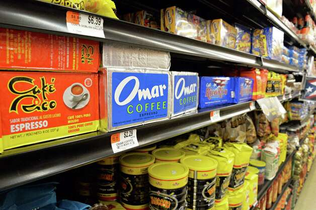 Some of the selection of coffee brands at the new Ideal Food Basket supermarket during their grand opening Friday, March 28, 2014, on Broadway in Menands, N.Y.  (John Carl D'Annibale / Times Union) Photo: John Carl D'Annibale / 00026306A