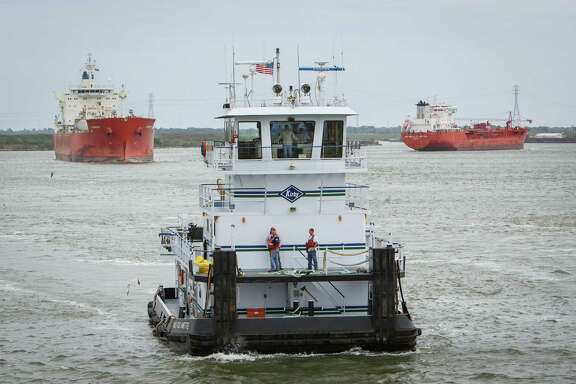 A Kirby towboat operates on the Houston Ship Channel, Wednesday, March 26, 2014.  Five people typically man the vessel as it transports barges along the waterways.  ( Michael Paulsen / Houston Chronicle )
