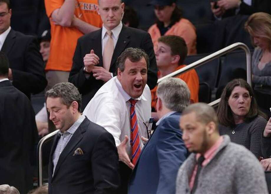 New Jersey Gov. Chris  Christie greets people during the second half in a regional semifinal  between Connecticut and Iowa State at the NCAA men's college basketball  tournament Friday, March 28, 2014, in New York. (AP Photo/Frank Franklin  II)