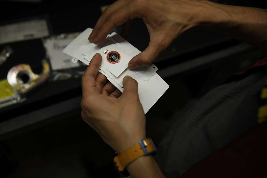 Manu Prakash assembles a Foldscope in his lab at Stanford. Prakash led the team that invented the Foldscope. Photo: Lea Suzuki, The Chronicle