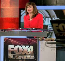 """FILE - This Feb. 24, 2014 file photo shows Maria Bartiromo during the debut of her """"Opening Bell with Maria Bartiromo""""  program on the Fox Business Network, in New York. Bartiromo debuts her one-hour program, """"Sunday Morning Futures,"""" at 10 a.m. ET. It will feature interviews with business leaders and roundtable discussions, with an emphasis on anticipating the financial stories of the upcoming week. (AP Photo/Richard Drew, File) ORG XMIT: NYET411"""