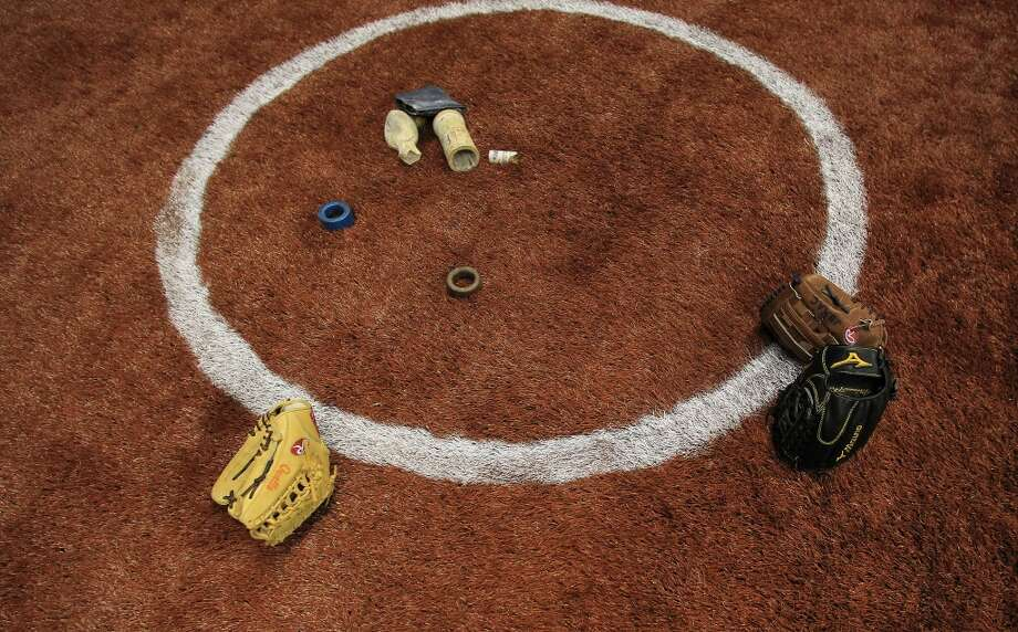 Astro turf on the on-deck circle before the start of the game. Photo: Karen Warren, Houston Chronicle
