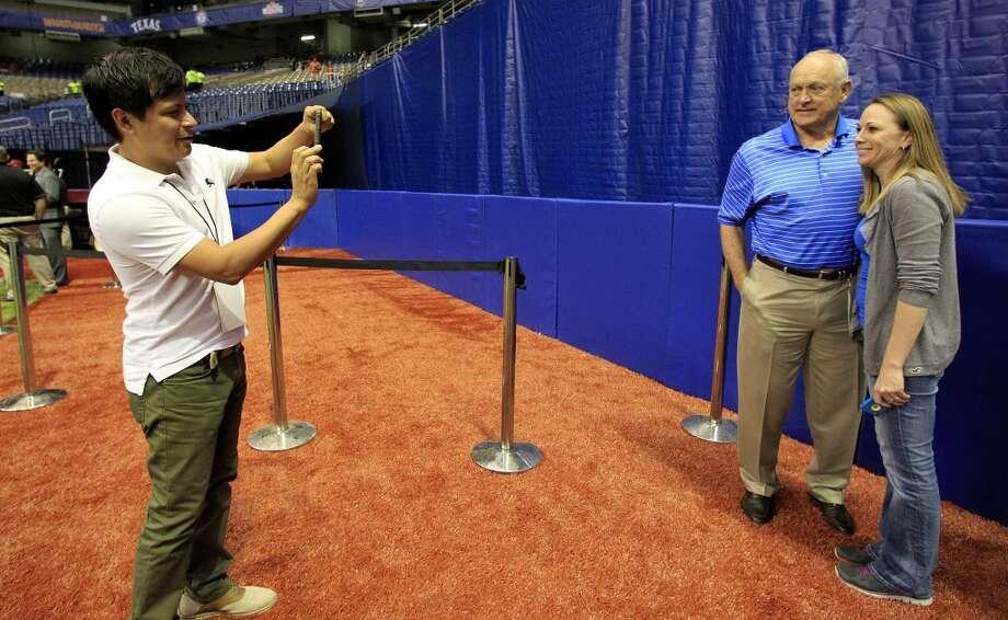 Jaime Buentello takes a photo of Nolan Ryan and Heather Breeze. Photo: Karen Warren, Houston Chronicle
