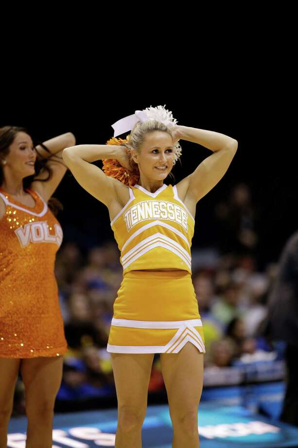 Tennessee cheerleaders perform during the second half of an NCAA Midwest Regional semifinal college basketball tournament game against the Michigan Friday, March 28, 2014, in Indianapolis. (AP Photo/David J. Phillip) Photo: David J. Phillip, Associated Press / AP