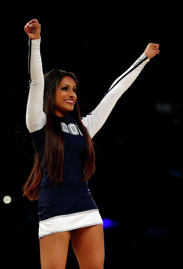 NEW YORK, NY - MARCH 28:  A cheerleader for the Connecticut Huskies performs during the regional semifinal of the 2014 NCAA Men's Basketball Tournament at Madison Square Garden on March 28, 2014 in New York City. Photo: Elsa, Getty Images / 2014 Getty Images