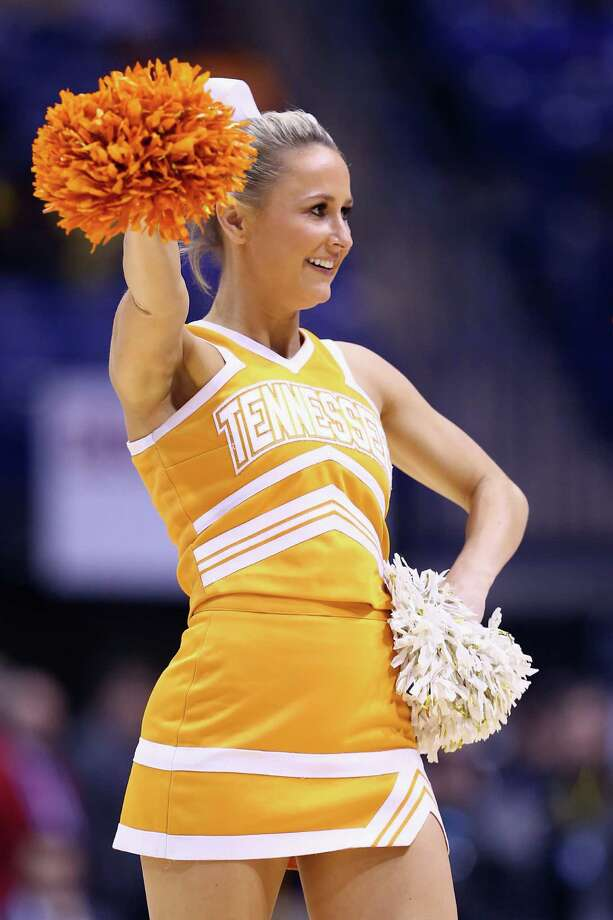 INDIANAPOLIS, IN - MARCH 28:  A Tennessee Volunteers cheerleader performs aginst Michigan Wolverines during the regional semifinal of the 2014 NCAA Men's Basketball Tournament at Lucas Oil Stadium on March 28, 2014 in Indianapolis, Indiana. Photo: Andy Lyons, Getty Images / 2014 Getty Images