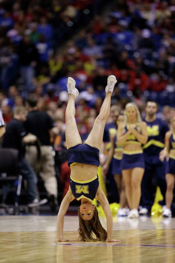 Michigan cheerleaders perform during the second half of an NCAA Midwest Regional semifinal college basketball tournament game against the Tennessee Friday, March 28, 2014, in Indianapolis. (AP Photo/David J. Phillip) Photo: David J. Phillip, Associated Press / AP