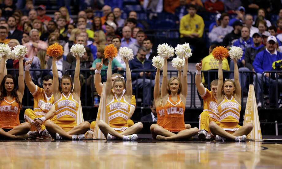 Tennessee cheerleaders perform during the first half of an NCAA Midwest Regional semifinal college basketball tournament game against the Michigan Friday, March 28, 2014, in Indianapolis. (AP Photo/Michael Conroy) Photo: Michael Conroy, Associated Press / AP