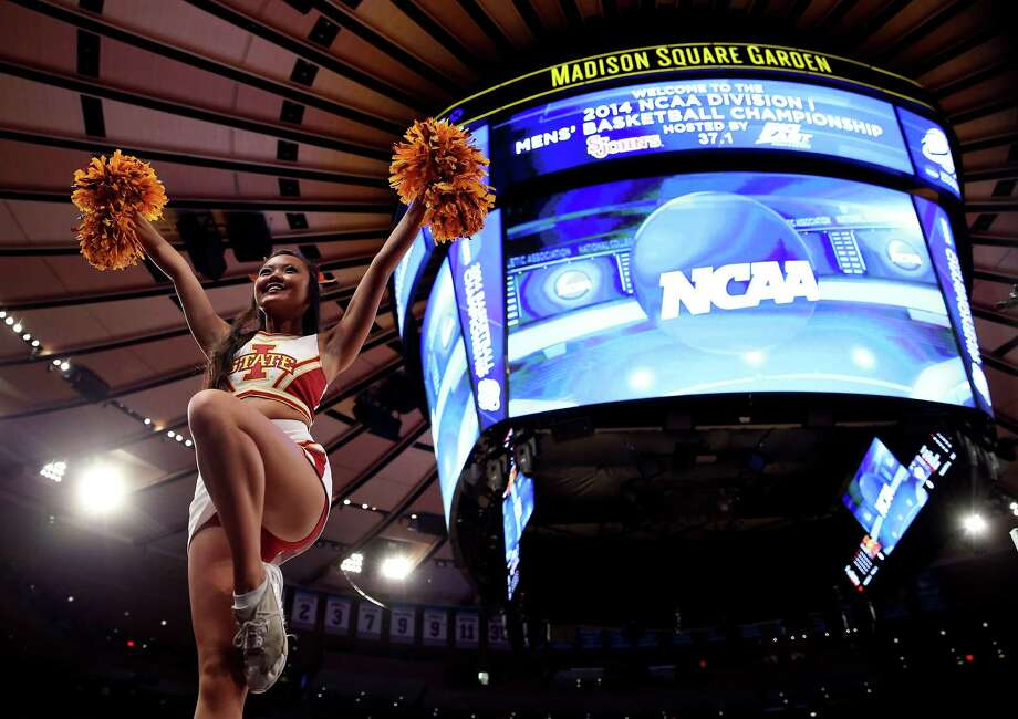 NEW YORK, NY - MARCH 28:  A cheerleader for the Iowa State Cyclones performs during the regional semifinal of the 2014 NCAA Men's Basketball Tournament at Madison Square Garden on March 28, 2014 in New York City. Photo: Bruce Bennett, Getty Images / 2014 Getty Images