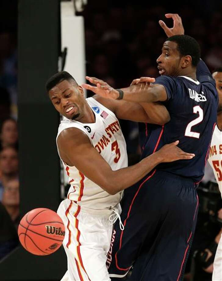 Iowa State's Melvin Ejim,  left, and Connecticut's DeAndre Daniels watch the ball get away during  the second half in a regional semifinal of the NCAA men's college  basketball tournament Friday, March 28, 2014 in New York. Connecticut  won 81-76. (AP Photo/Seth Wenig)