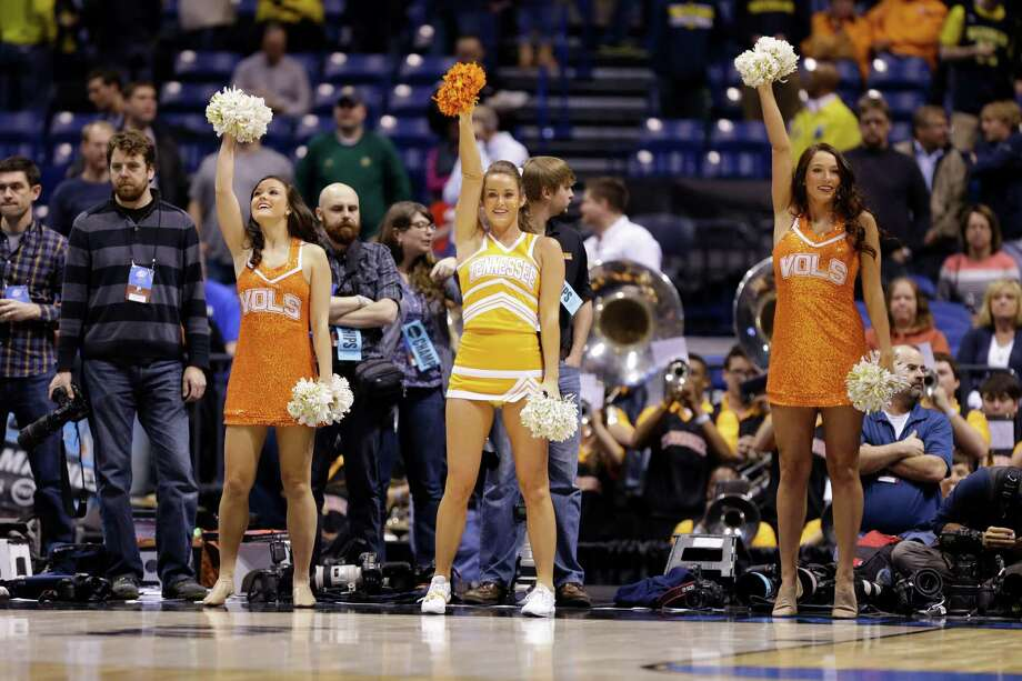 Tennessee cheerleaders perform during the first half of an NCAA Midwest Regional semifinal college basketball tournament game Friday, March 28, 2014, in Indianapolis. (AP Photo/Michael Conroy) Photo: Michael Conroy, Associated Press / AP