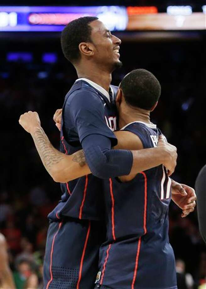 Connecticut's DeAndre  Daniels, left, hugs teammate Ryan Boatright.