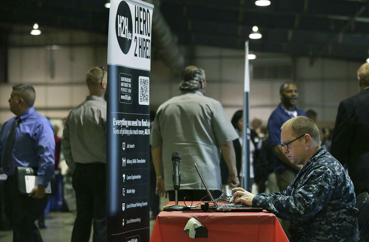 Henry Steele, who is in the Navy, enters his information in the Hero2Hire database at the Veterans Information Village and Military Job Fair at Freeman Coliseum last week. People there said they were pleased by how many companies are hiring.