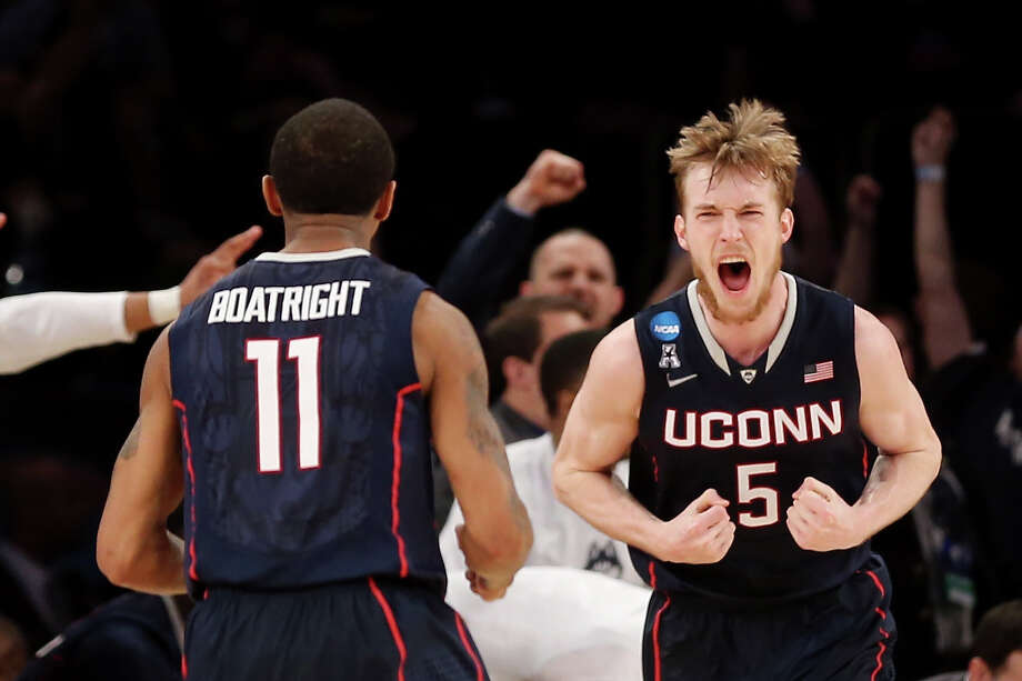 Don't miss the action when the UConn men take on the University of Florida for a spot in the NCAA championship game. The game airs on TBS Saturday at 6:09 p.m. Photo: Bruce Bennett, Getty Images / 2014 Getty Images