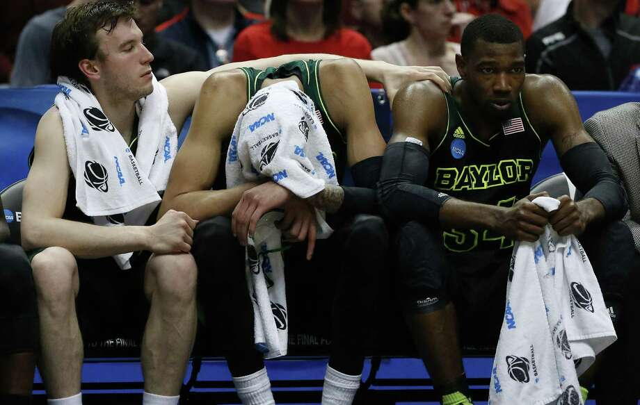 Baylor's Brady Heslip (left) consoles Cory Jefferson (right) as Isaiah Austin hangs his head during the Bears' loss to Wisconsin. Baylor loses Heslip and Jefferson to graduation. Photo: Robert Gauthier / McClatchy-Tribune News Service / Los Angeles Times