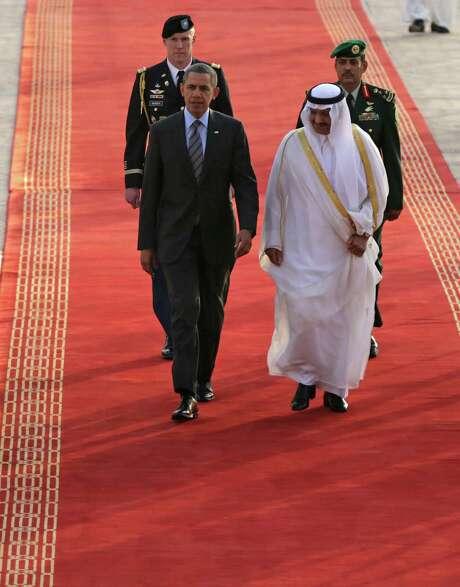 President Barack Obama is welcomed by Prince Khalid Bandar bin Abdul-Aziz Al-Saud, the governor of Riyadh, upon the president's arrival in the capital of Saudi Arabia. Photo: Hasan Jamali / Associated Press / AP