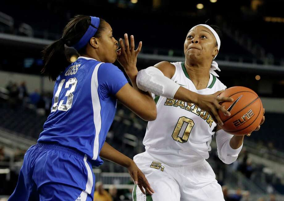 A berth in the Elite Eight will be at stake Saturday when Kentucky's Bria Goss (13) and Baylor's Odyssey Sims (0) meet for the second time this season. Photo: Tony Gutierrez, STF / AP