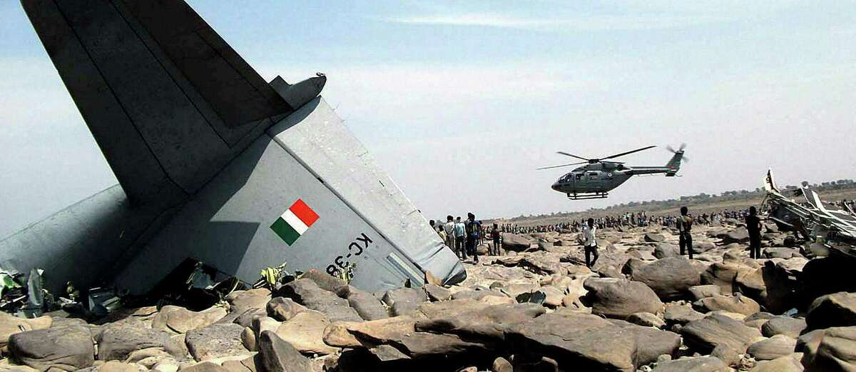 An Indian air force helicopter hovers over the site where an air force cargo plane crashed in central India.