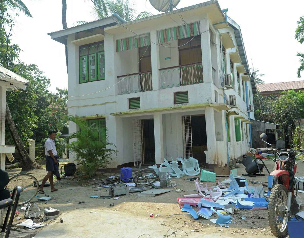 Debris from damage caused by Buddhist mobs attacking international aid groups litters the front of a damaged non-governmental organizations office in Sittwe in western Myanmar.