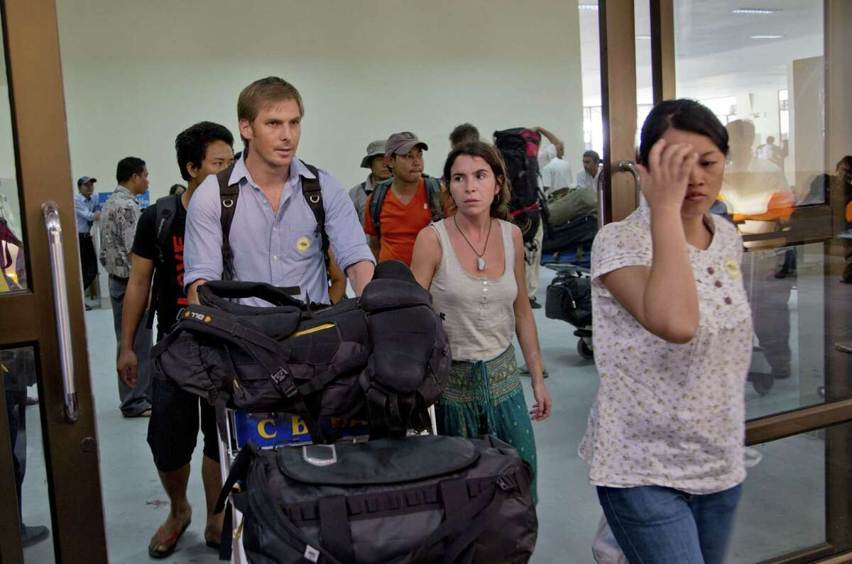 International and national staff members of non-governmental organizations flee Sittwe, Myanmar, to a domestic airport in Yangon after Buddhist-led mobs targeted aid organizations.