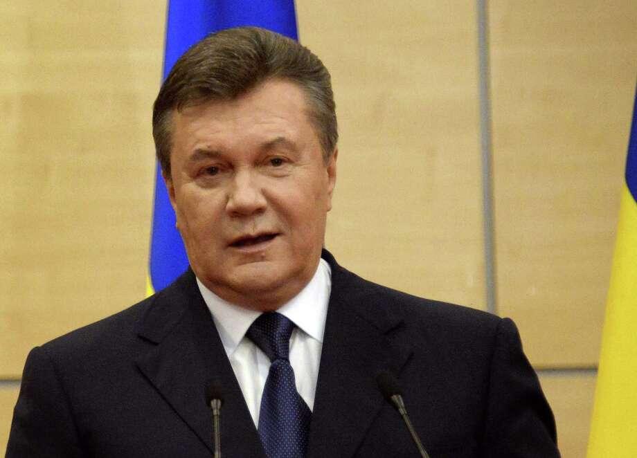 "Deposed Ukrainian President Viktor Yanukovych said, ""Only an all-Ukrainian referendum"" could ""preserve Ukraine's sovereignty."" Photo: Alexander Nemenov / Getty Images / AFP ImageForum"