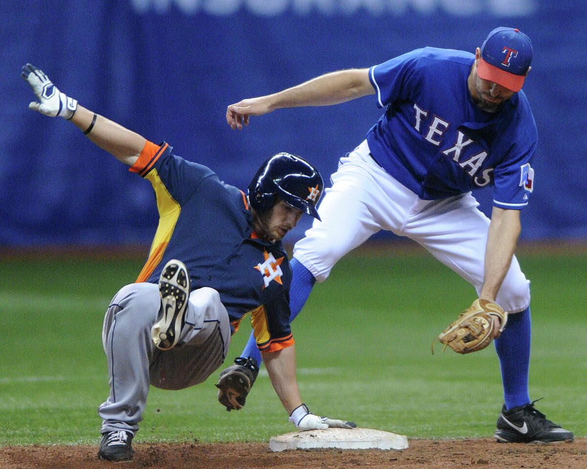 Alex Presley of the Houstaon Astros gets back to second base as Adam Rosales applies a tag during Big League Weekend baseball action in the Alamodome on Friday, March 28, 2014.