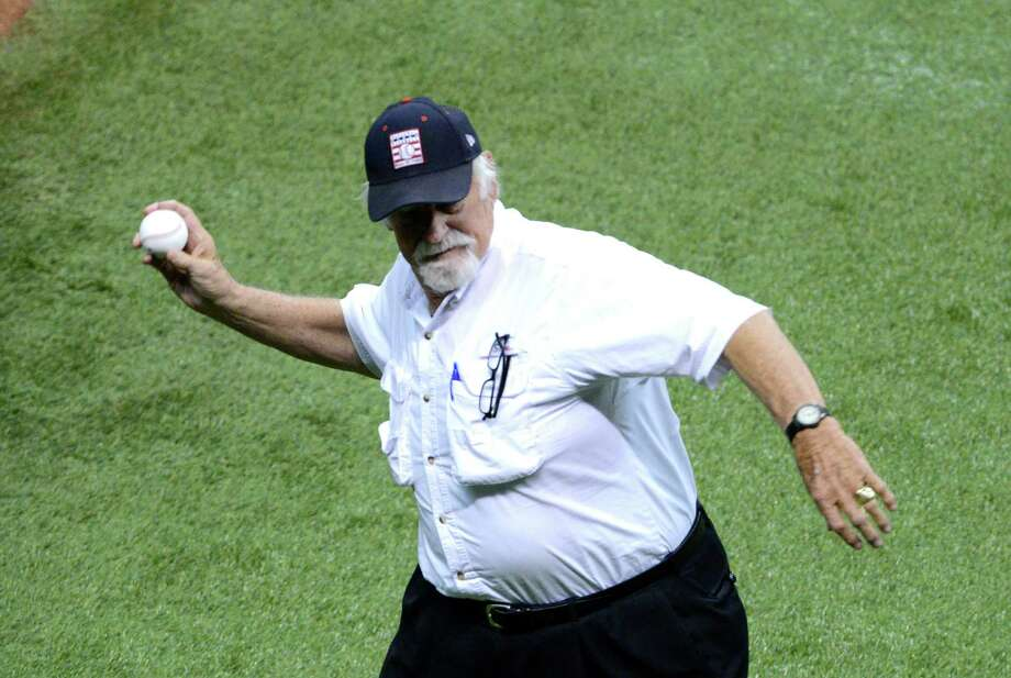 Pitching legend and Hall of Fame member Gaylord Perry throws the first pitch during Big League Weekend baseball action in the Alamodome on Friday, March 28, 2014. Photo: Billy Calzada, San Antonio Express-News / San Antonio Express-News