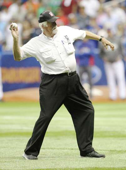 Baseball Hall of Fame member Gaylord Perry throws the ceremonial first pitch before the Big League W