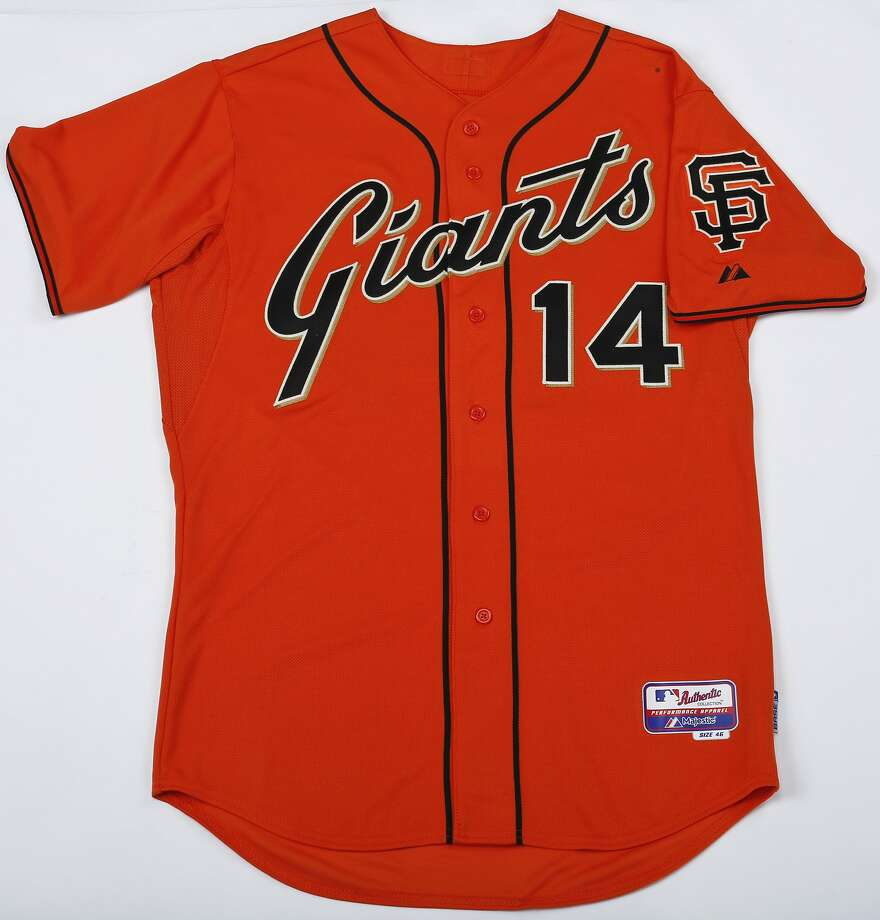 San Francisco Giants Authentic 2014 Personalized Alternate Cool Base jersey ($250.99, http://shop.mlb.com). The 2014 tweak is a big one, scrapping the block type Giants logo and replacing it with something that longtime fans will happily recall, the script logo from the late '70s and early '80s. Photo: Russell Yip, The Chronicle