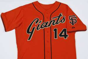 San Francisco Giants Authentic 2014 Personalized Alternate Cool Base jersey ($250.99, http://shop.mlb.com). The 2014 tweak is a big one, scrapping the block type Giants logo and replacing it with something that longtime fans will happily recall, the script logo from the late '70s and early '80s.