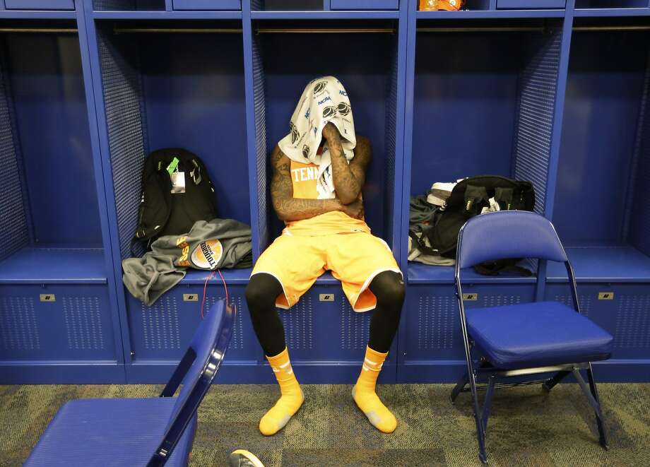Tennessee guard Antonio Barton (2) looks down in the locker room after an NCAA Midwest Regional semifinal college basketball tournament game Friday, March 28, 2014, in Indianapolis. Michigan won 73-71. (AP Photo/Michael Conroy) Photo: Michael Conroy, Associated Press