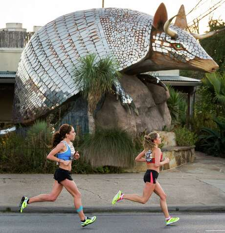 Marathoners like Kara Lubieniecki, right, and Alia Gray, might want to scale back on their running regimen, according to a new report. Photo: Smiley N. Pool, Staff / © 2014  Houston Chronicle