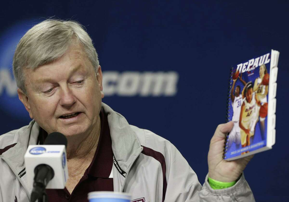 A&M coach Gary Blair, holding a DePaul media guide, expects the game vs. the Blue Demons to be quite entertaining for fans.