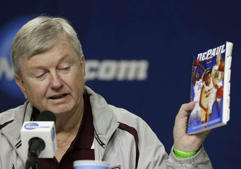 A&M coach Gary Blair, holding a DePaul media guide, expects the game vs. the Blue Demons to be quite entertaining for fans. Photo: Nati Harnik / Associated Press / AP