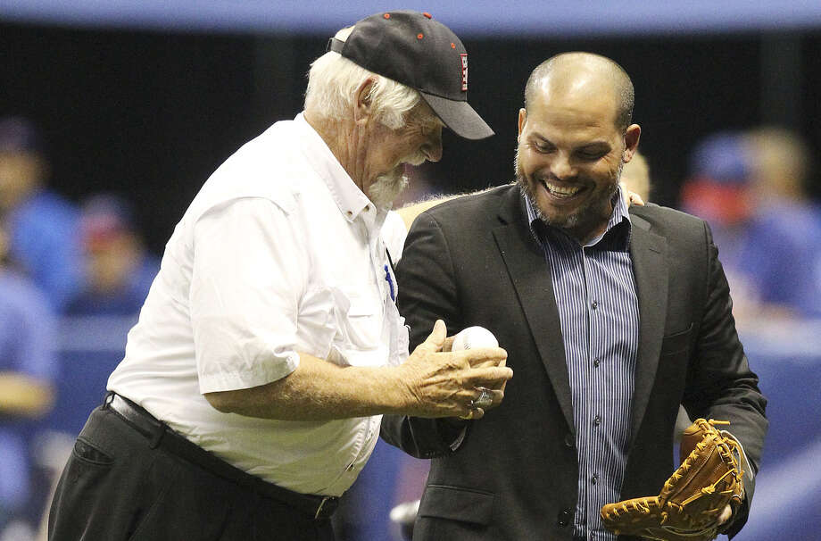 "Baseball Hall of Fame member Gaylord Perry (left) and former MLB catcher Ivan ""Pudge"" Rodriguez gather after the ceremonial first pitch at the Big League Weekend Major League Baseball exhibition game between the Houston Astros and the Texas Rangers at the Alamodome  on Friday, Mar. 28, 2014. Photo: Kin Man Hui, San Antonio Express-News / ©2014 San Antonio Express-News"